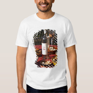 Aperitif and appetizers prepared: bread, olives, tshirt