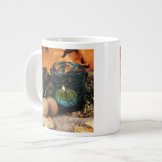 Autumnal composition with candle and leaves jumbo mug