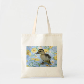 baby duckling on flowered background left budget tote bag