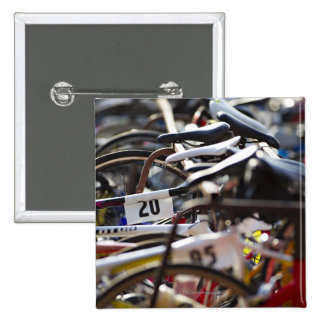 Bicycles on the rack at a triathlon race ready 15 cm square badge