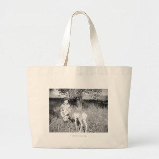 Boy feeding antelope by hand jumbo tote bag