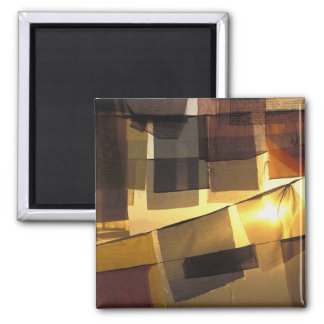 Buddhist prayer flags in the sunset, square magnet