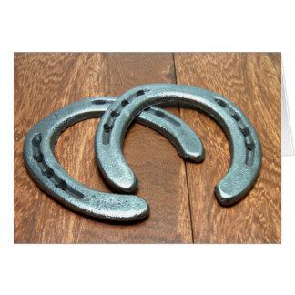 Cast iron horseshoes on barn wood note card