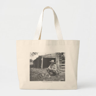 Cat eating out of a coffee can. jumbo tote bag