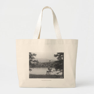 Cattle by a pond with two cowboys. jumbo tote bag