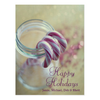 Christmas candy canes in glass jar postcard