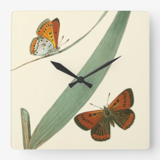 Colorful Butterflies Fluttering Around a Leaf Wall Clock