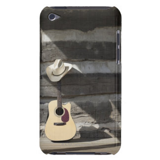 Cowboy hat on guitar leaning on log cabin iPod touch case