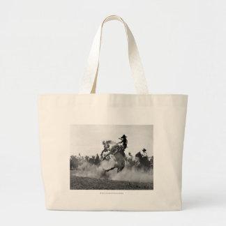 Cowboy on a bucking bronco jumbo tote bag