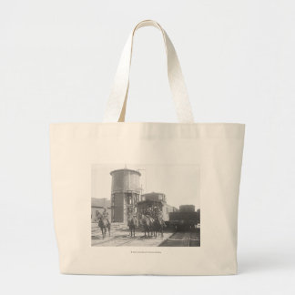 Cowboys on horses posing in front of a train jumbo tote bag