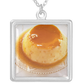 Creme caramel type of pudding with caramel square pendant necklace