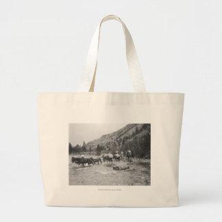 Driving pack mules across a river jumbo tote bag