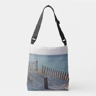 Dune fence and sandy beach tote bag