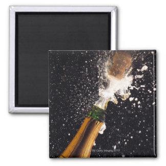 Exploding champagne bottle square magnet