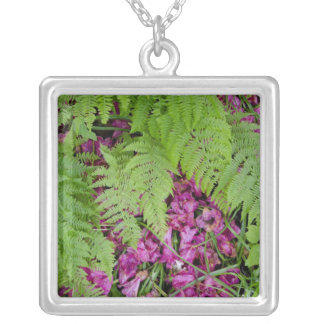 Forest ferns with pink flower petals on ground square pendant necklace