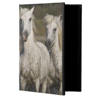 France, Camargue. Horses run through the 2 iPad Air Covers