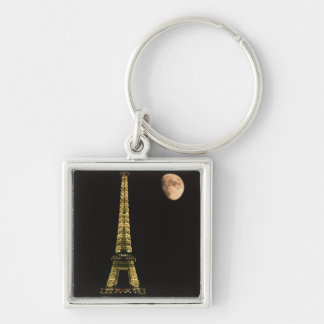 France, Paris. Eiffel Tower at night with Silver-Colored Square Key Ring
