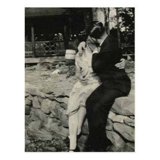Kissing on the stone wall postcard