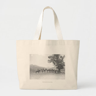 Men with packhorses looking over a hill jumbo tote bag