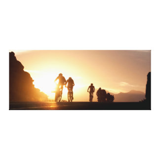 Mountain Bike Riders Make Their Way Over The Top Canvas Prints