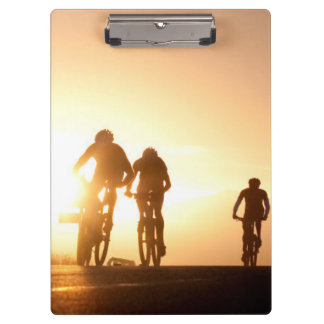 Mountain Bike Riders Make Their Way Over The Top Clipboard