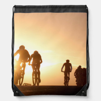 Mountain Bike Riders Make Their Way Over The Top Drawstring Bags