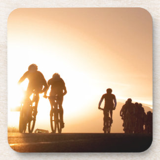 Mountain Bike Riders Make Their Way Over The Top Drink Coaster