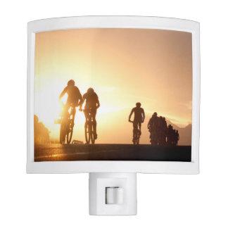Mountain Bike Riders Make Their Way Over The Top Nite Light