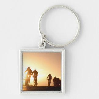 Mountain Bike Riders Make Their Way Over The Top Silver-Colored Square Key Ring