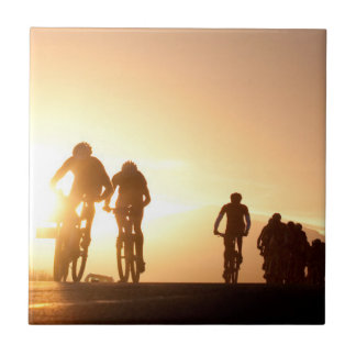 Mountain Bike Riders Make Their Way Over The Top Small Square Tile