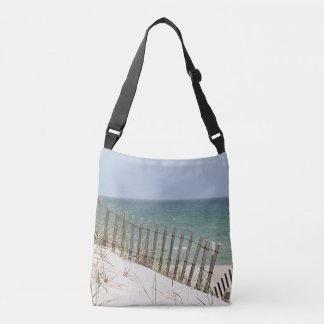Ocean view through the beach fence tote bag