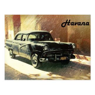Old American car on the street in Havana postcard