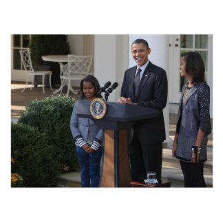 President Barack Obama pardons the Postcard