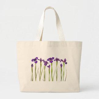 Purple irises isolated on a white background jumbo tote bag