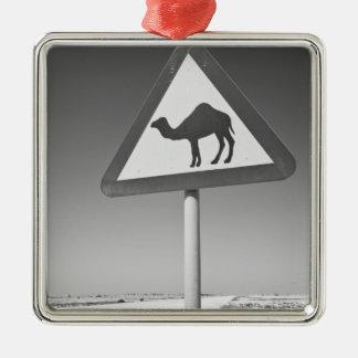 Qatar, Al Zubarah. Camel Crossing Sign-Road to Silver-Colored Square Decoration