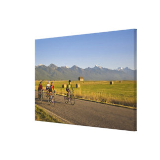 Road bicyclists ride down a back country road stretched canvas print