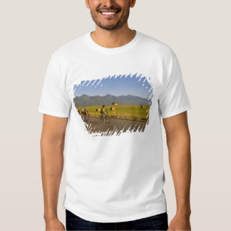 Road bicyclists ride down a back country road t shirts