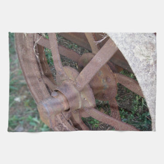 Rusty iron wheel of old cart towels