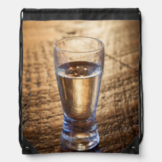 Single shot of Tequila on wood table Drawstring Bag