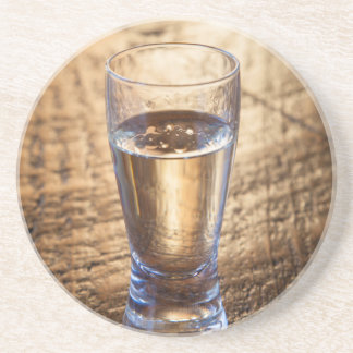 Single shot of Tequila on wood table Drink Coasters