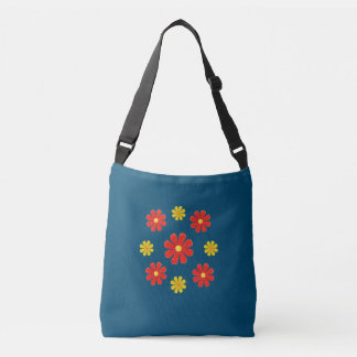 Spring red and yellow flowers on blue tote bag