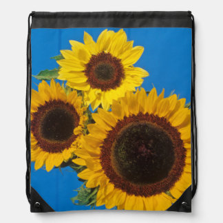 Sunflowers against blue fence backpack