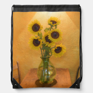 Sunflowers in vase on table 2 backpack