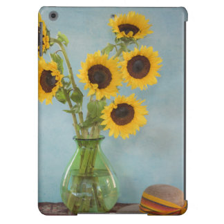 Sunflowers in vase on table iPad air cases
