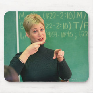 Teacher talking and pointing at front of mouse pad