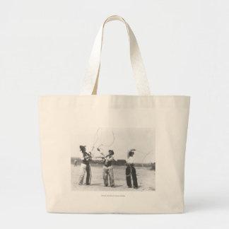 Three men lassoing. jumbo tote bag