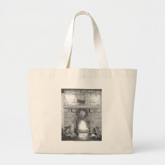 Two girls sitting by a fireplace at Christmas Jumbo Tote Bag