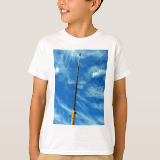 Upward view on the boom of a crane t shirts