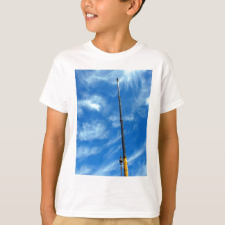 Upward view on the boom of a crane tee shirts