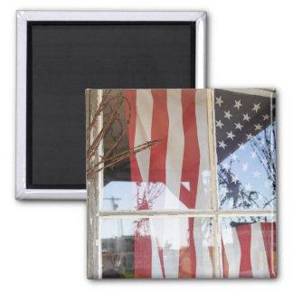 USA, Oregon, Shaniko. Flag in window next to Square Magnet